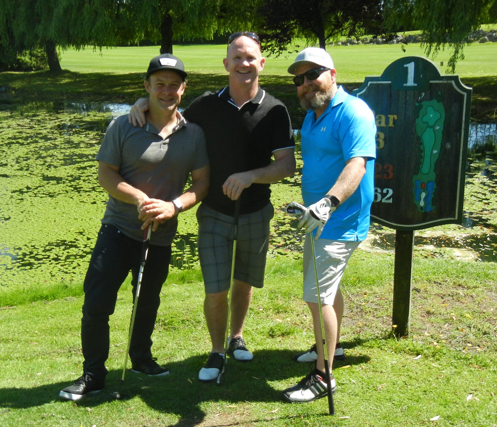 Team building playing golf