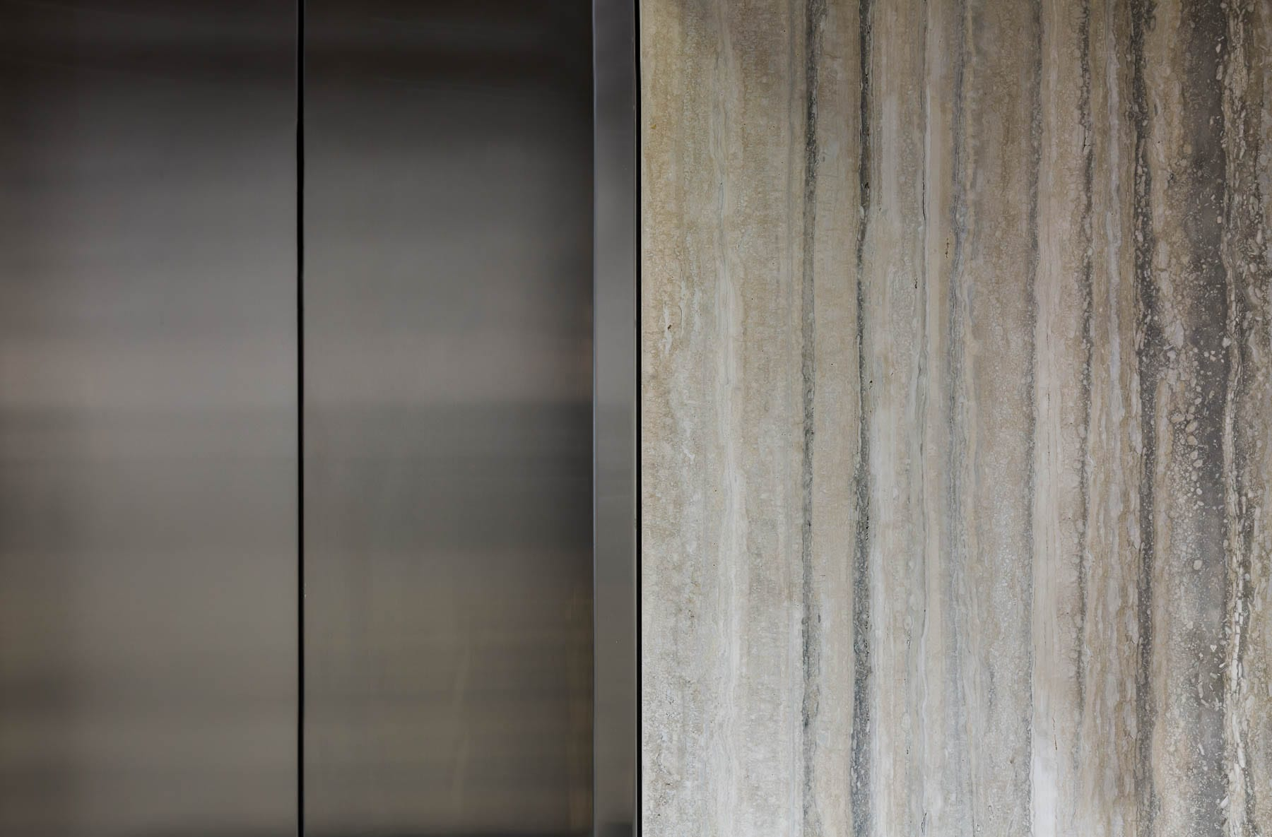 Closeup of elevator and wall details at 475 West Georgia newly renovated lobby