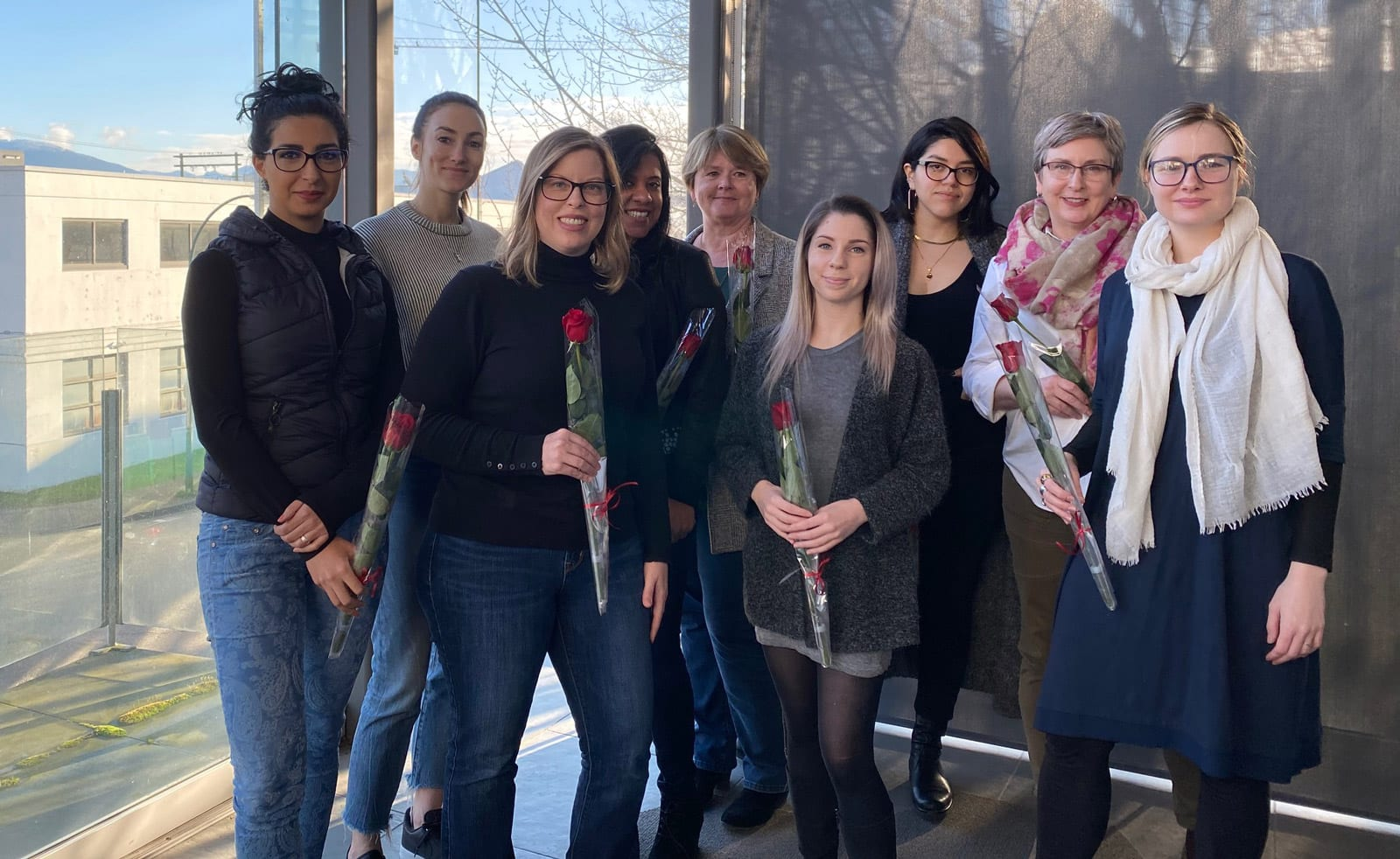 Ladies at CDC Construction celebrating International Women's Day with roses in hand
