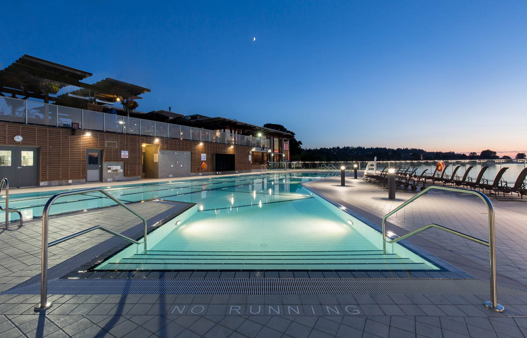Renovated point grey outdoor swimming pool near night time