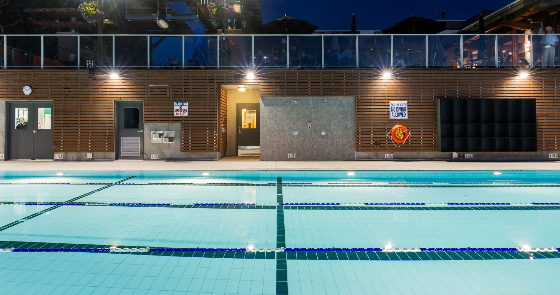 Renovated Jericho tennis club outdoor swimming pool with in-pool lighting