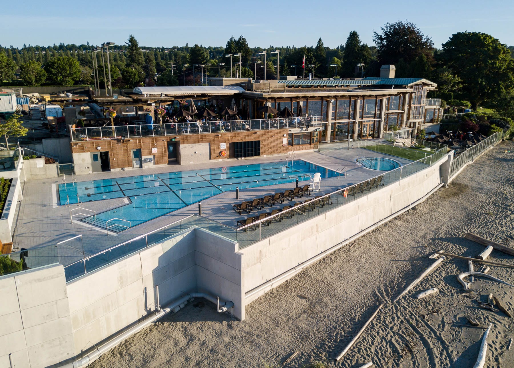 Jericho outdoor swimming pool with new outdoor showers, glass guardrails, outdoor benches, planters, stairs, and landscaping as well as improving the barbeque area and lower dining area