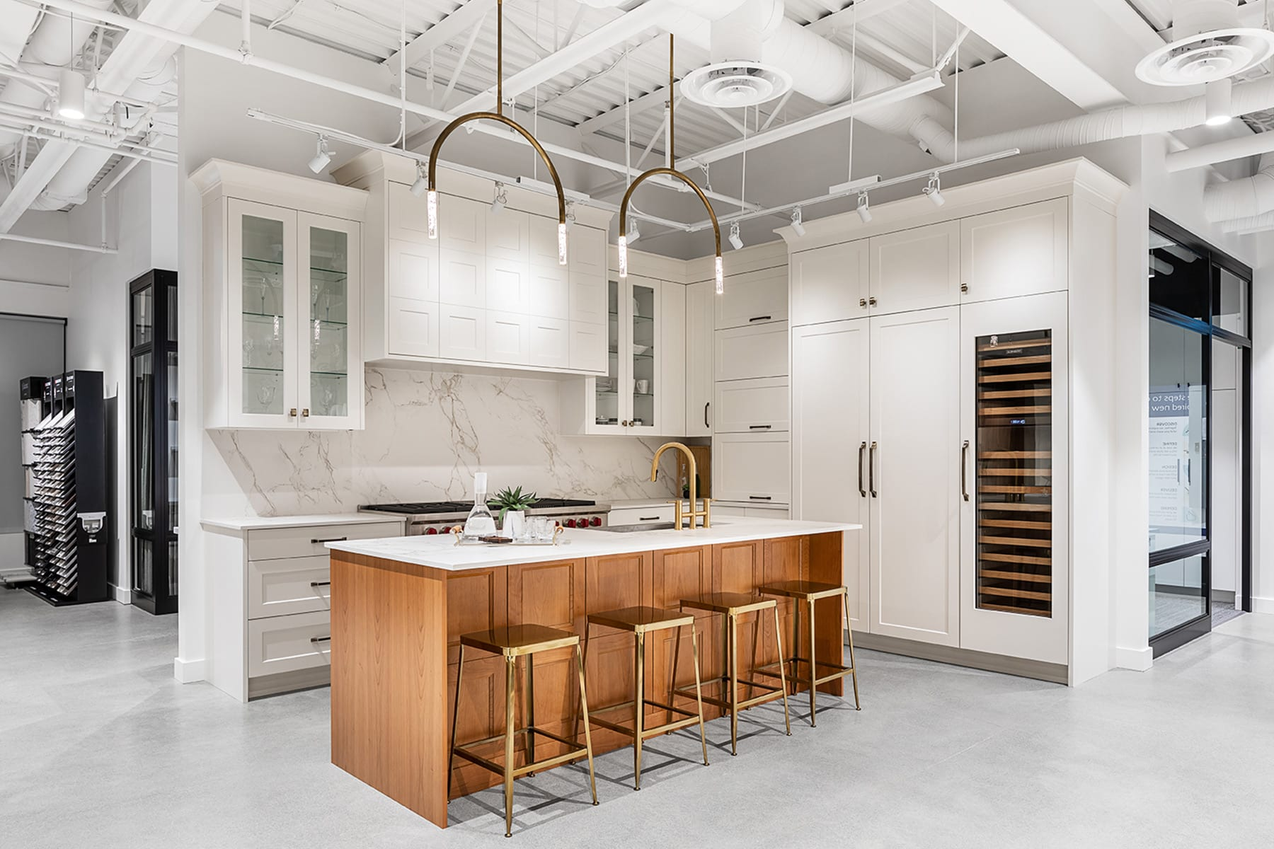 Full interior demolition and fit-out at KAD's new Richmond showroom. High grade kitchen vignette in a sleek white, gold palette