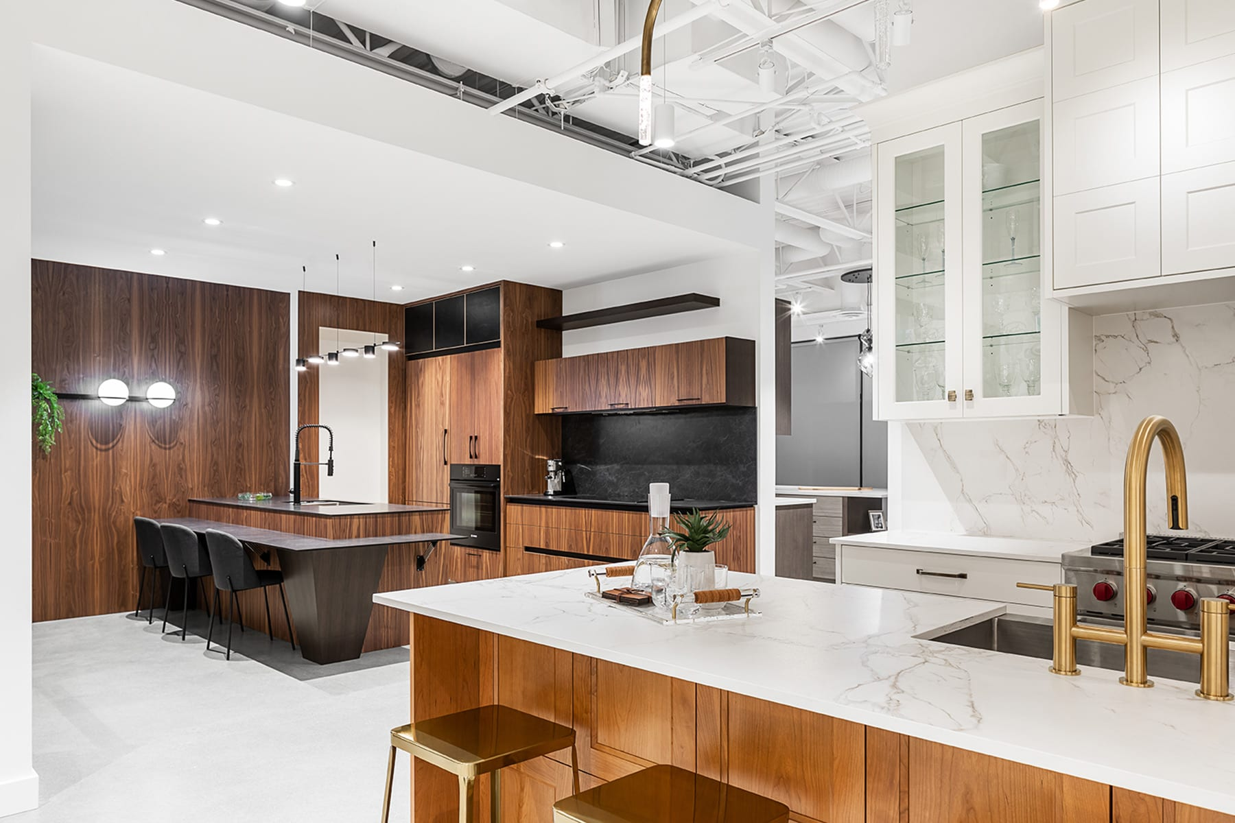 Kitchen Art Design showroom in Richmond BC. Full interior demolition, new walls, showroom kitchenettes, cabinets, new finishes, concrete floor, painting and drywall, open ceiling. Kitchens with high grade finishes.