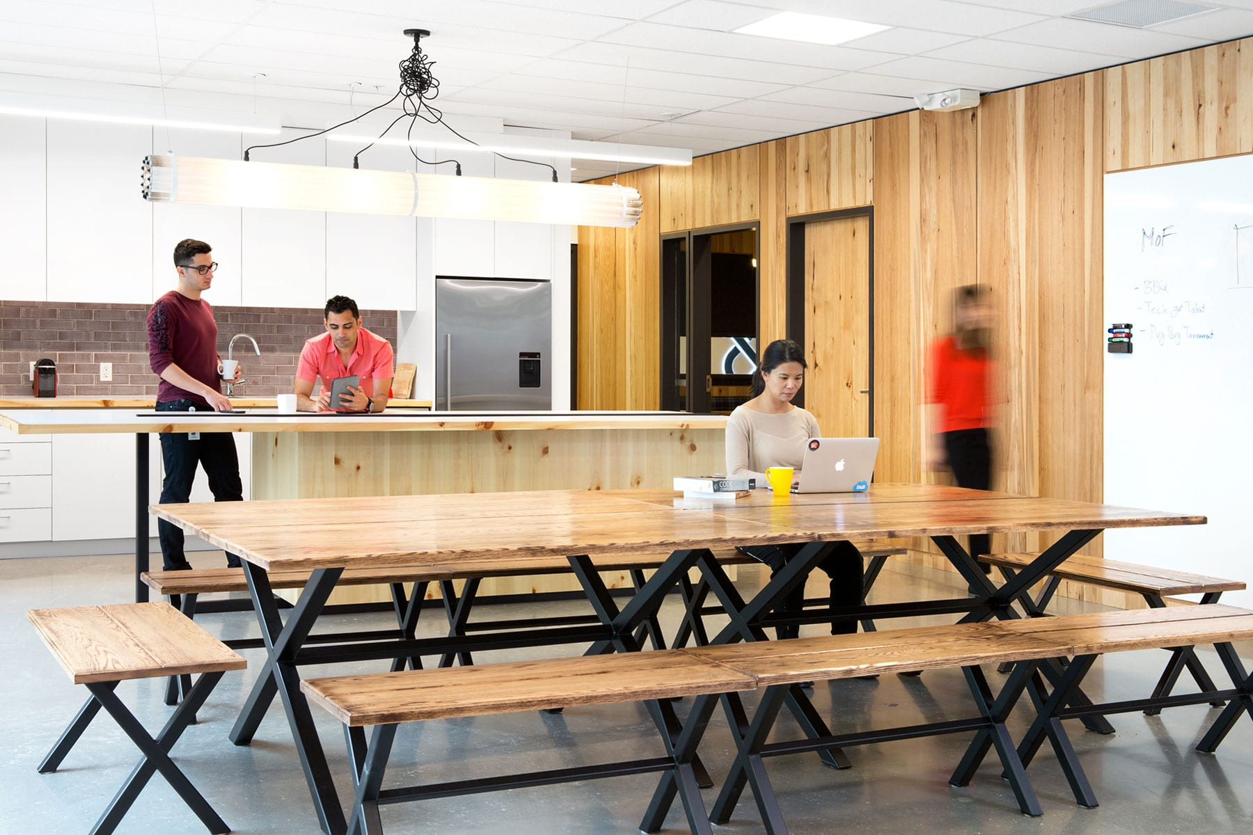 Hickory wood paneling, concrete floors and specialized lighting at staff kitchen area