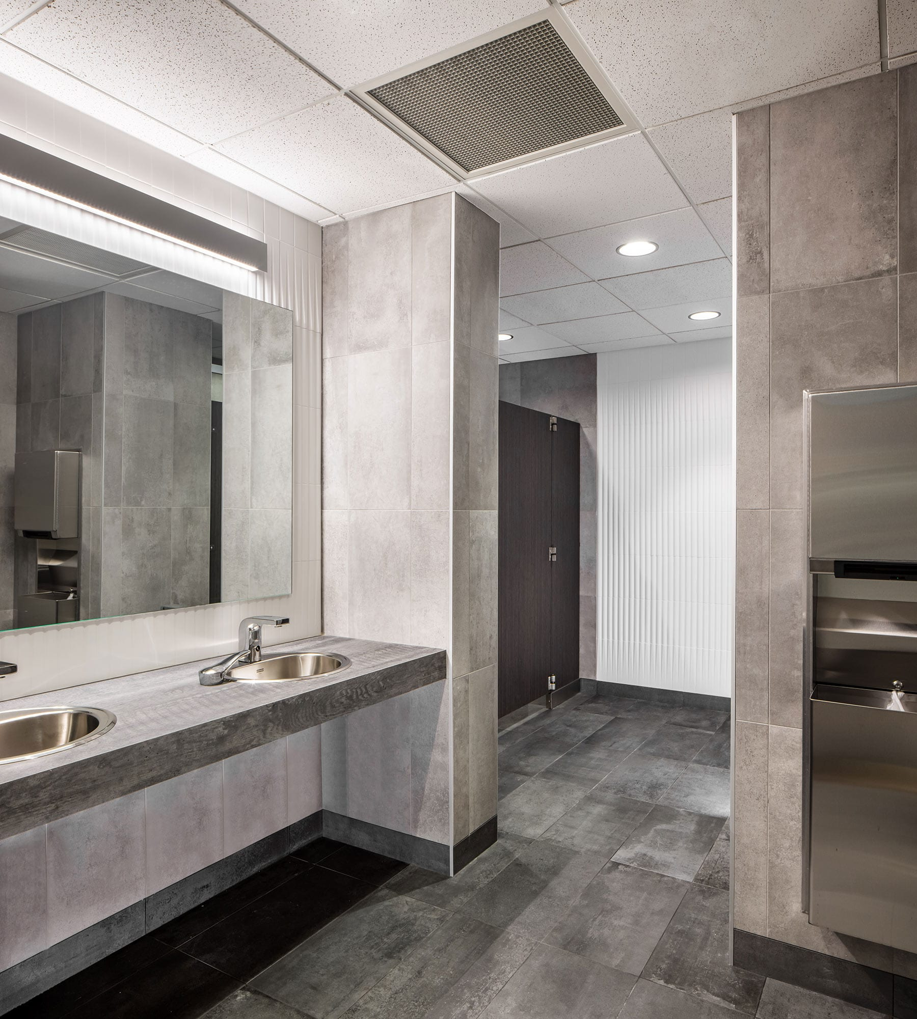 Commercial office building restroom refresh with premium upgrades