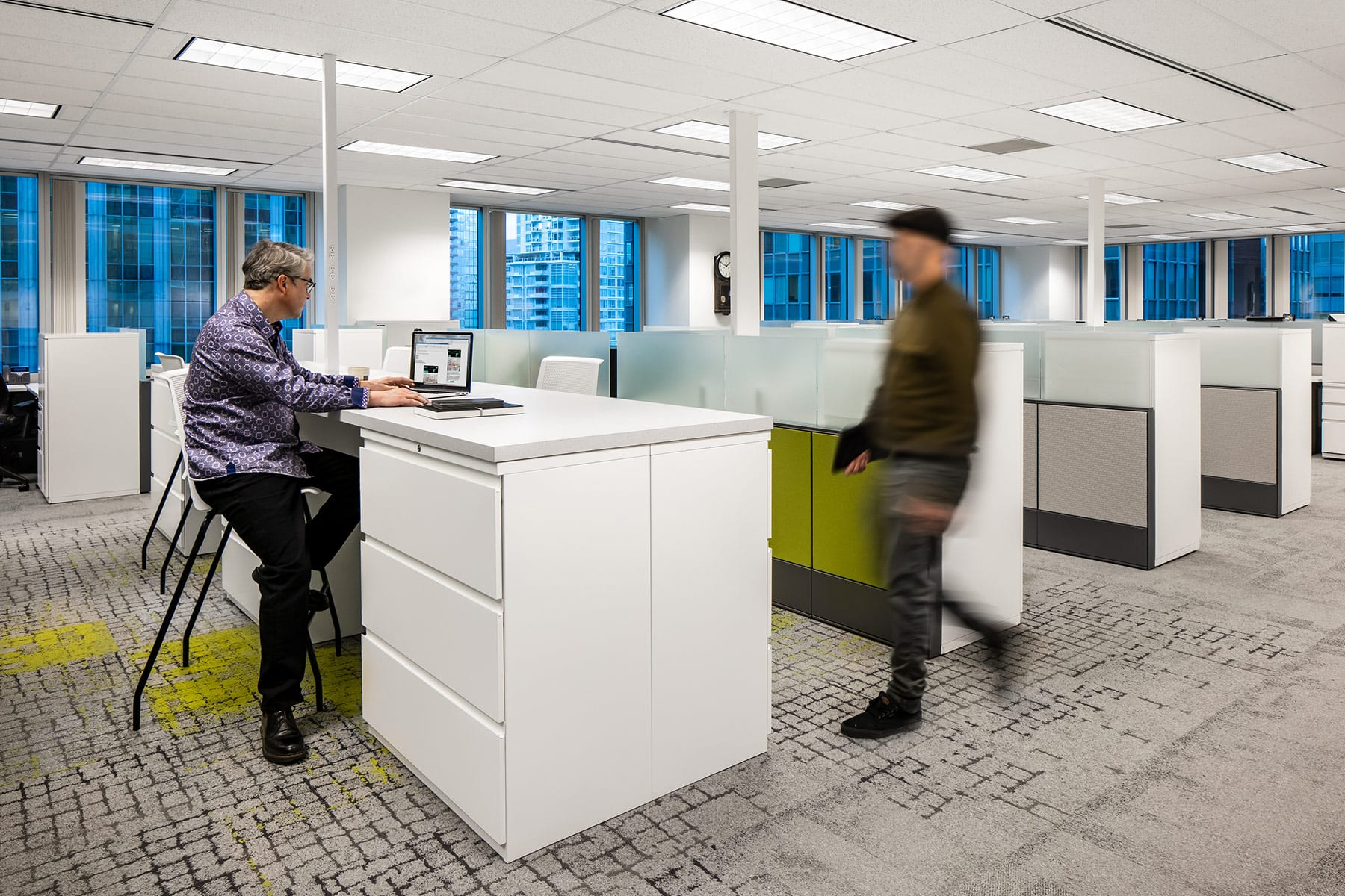 Downtown LEED building interior buildout with open plan workstations and filing cabinet