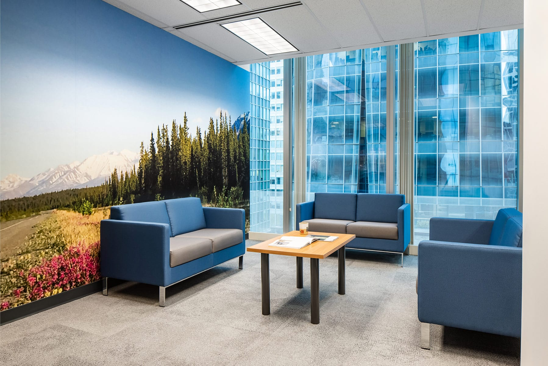 Downtown office renovation with new lounge and colourful wall graphics