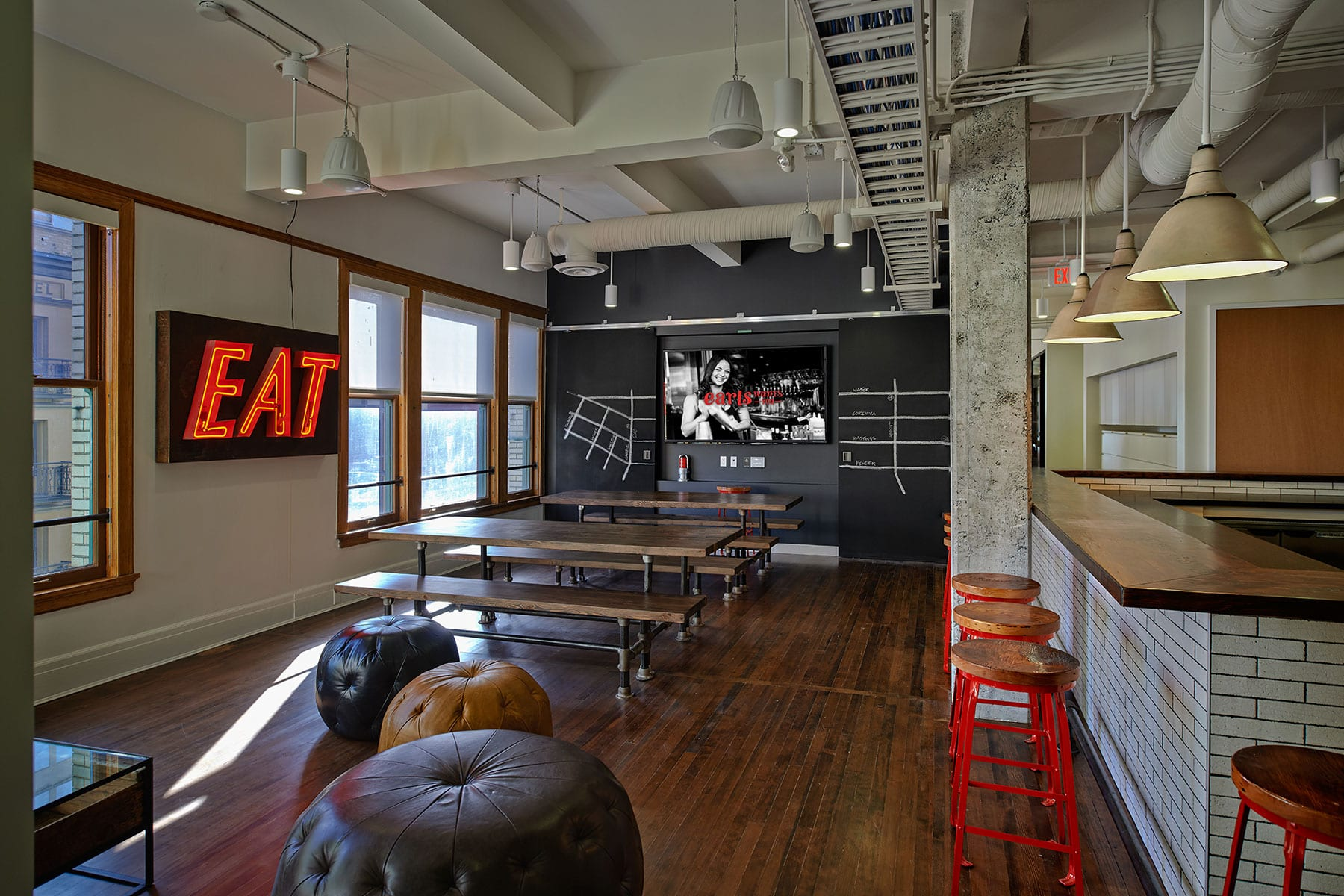 staff social lounge, lunch room, giant EAT sign at Earls head office in Vancouver