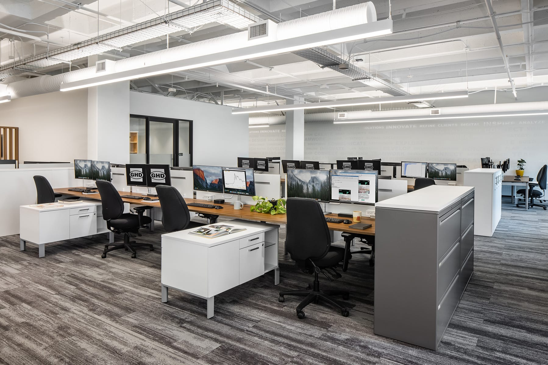 Construction Management Services for GHD's open-plan office with new flooring, vinyl graphics, open ceiling and new mechanical layouts