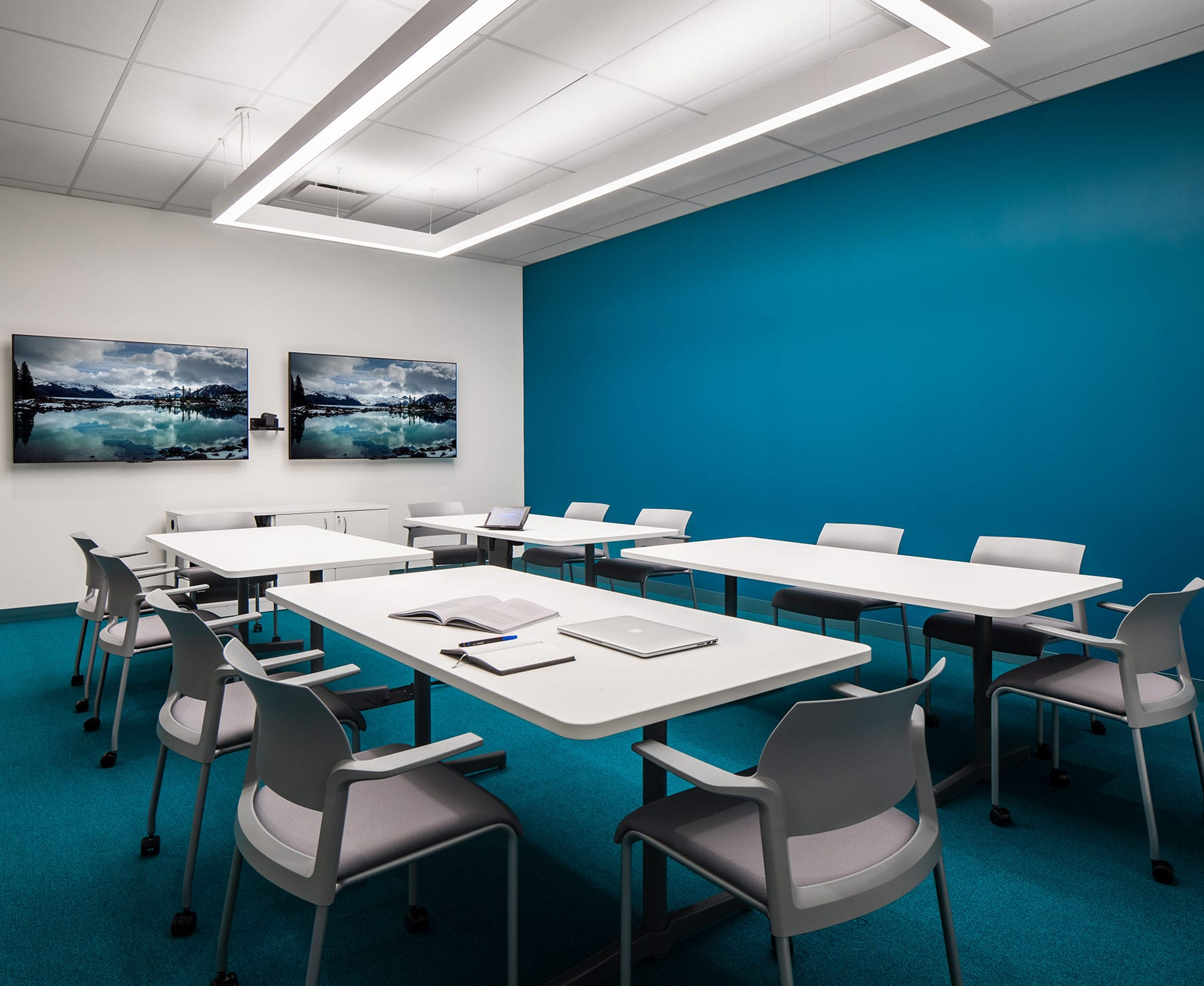 Corporate contemporary office boardroom with blue walls and blue carpets