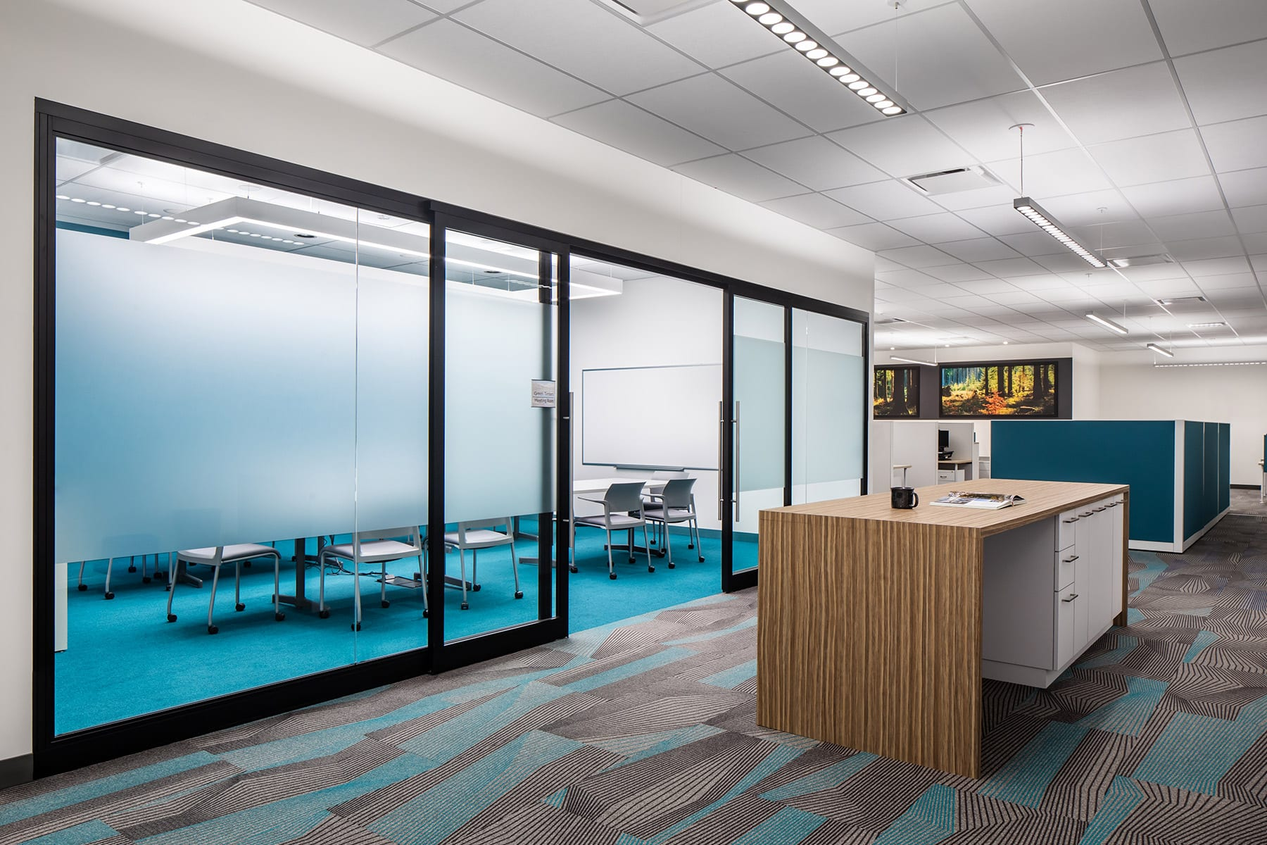Tenant improvement for Health Informatics' office with T bar ceilings, partition glazing system, workstations and large meeting room