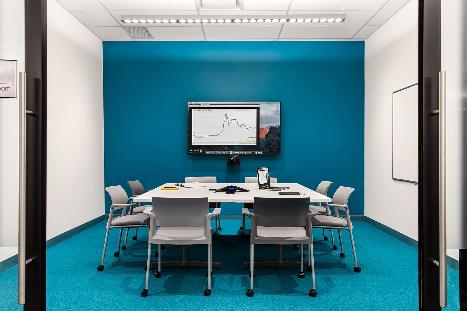 Fraser Health Health Informatics office meeting room with acoustic ceilings and sky blue painted walls
