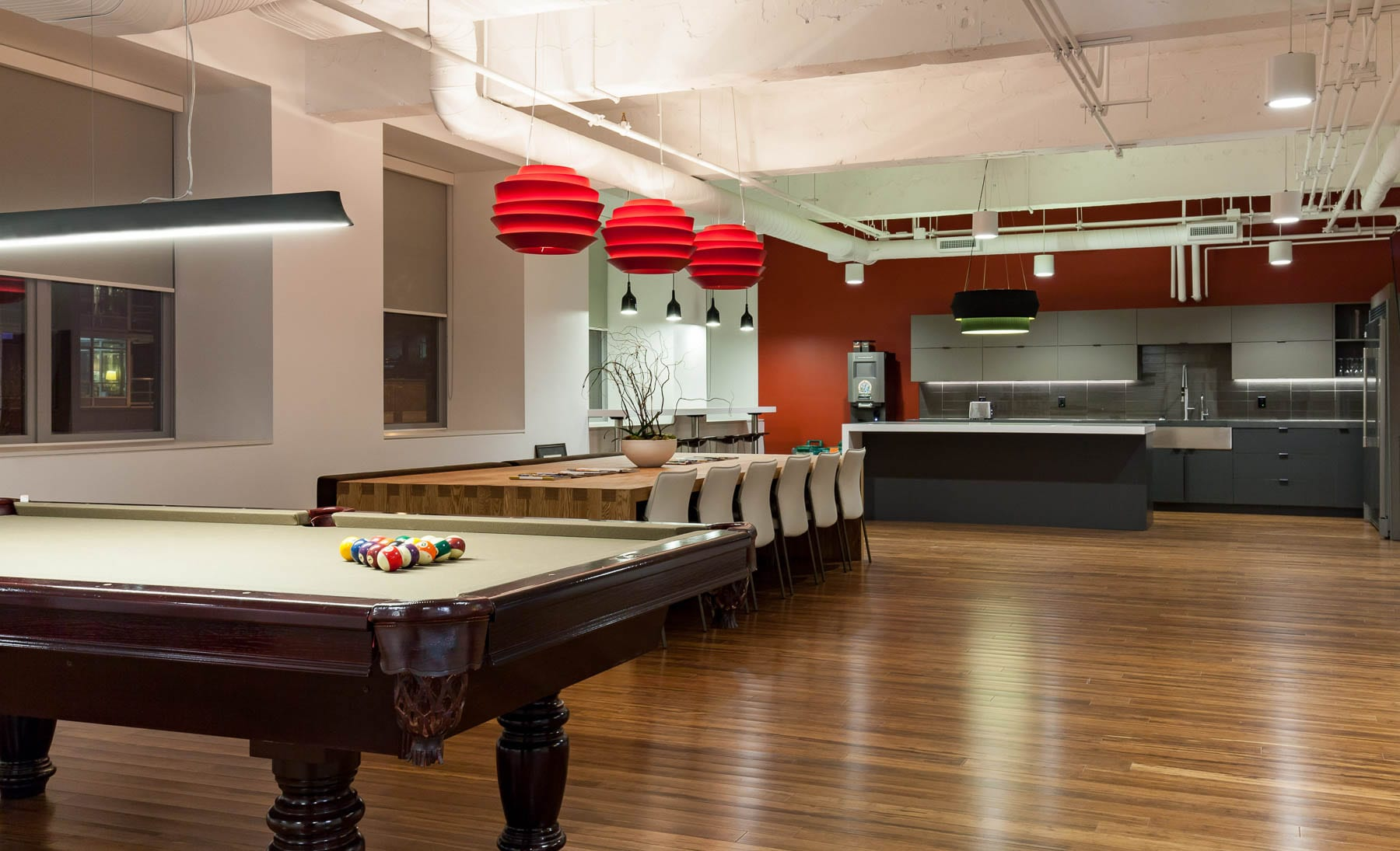 MIABC office's interior improvements - kitchen with exposed ceiling, pool table
