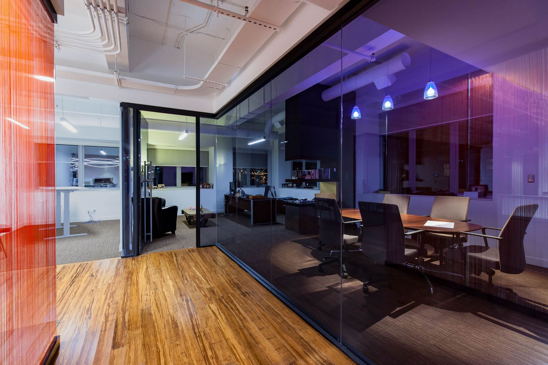 Contemporary Office TI at MIABC with glazed modular walls used for the office fronts