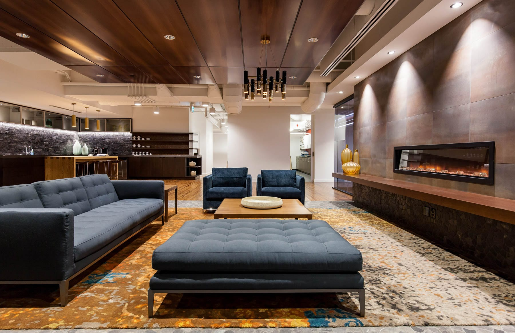 Contemporary Office Design at MIABC - living room style lounge with fireplace