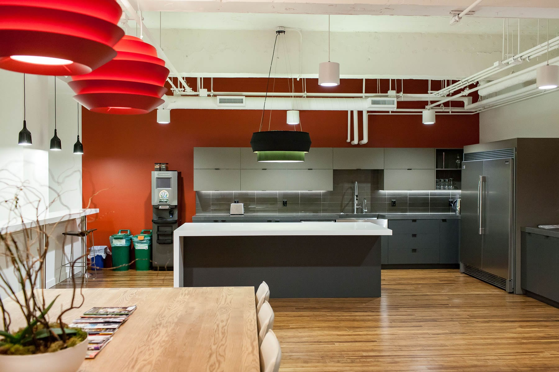 MIABC office's interior improvements - kitchen with exposed ceiling and painted white