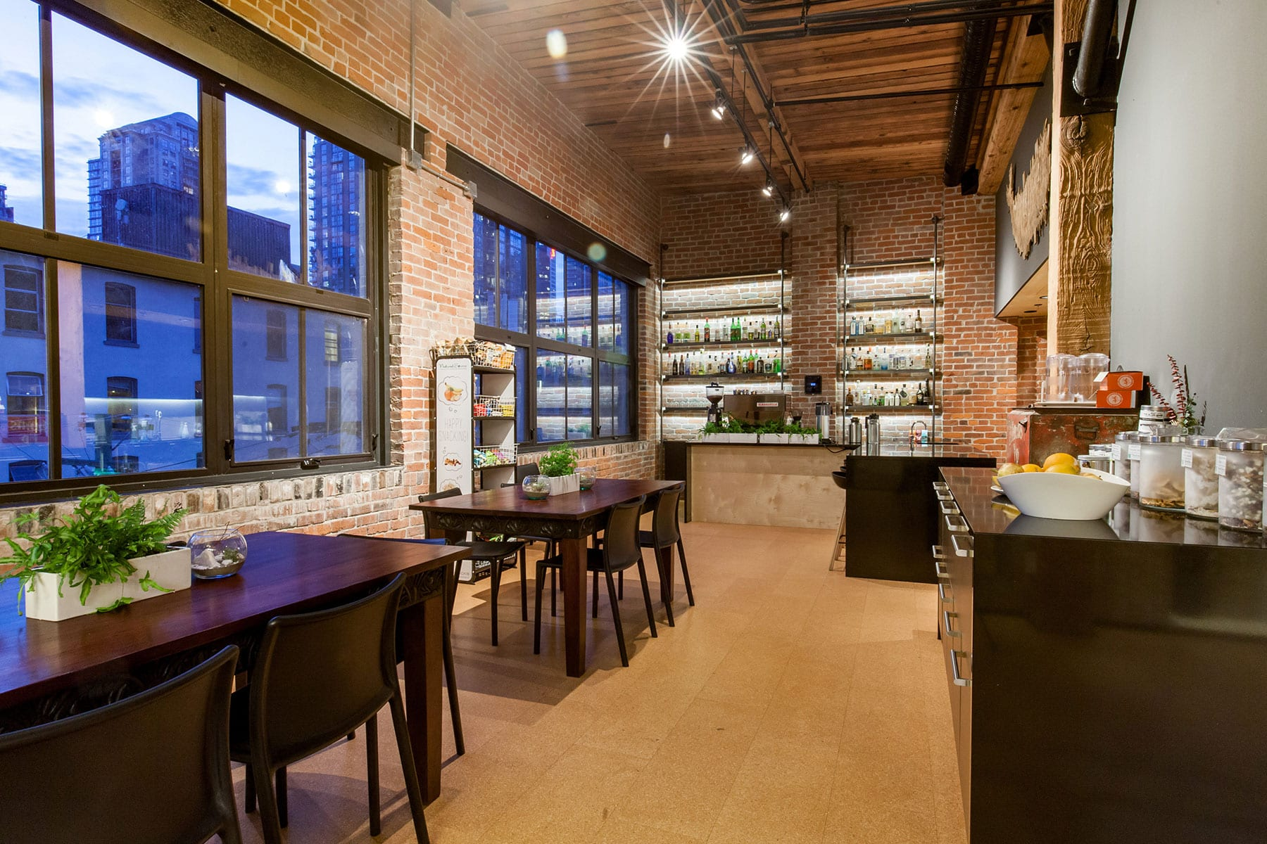 Social space and kitchen staff room with exposed brick in an industrial atmosphere of a tech company headquartered in Yaletown