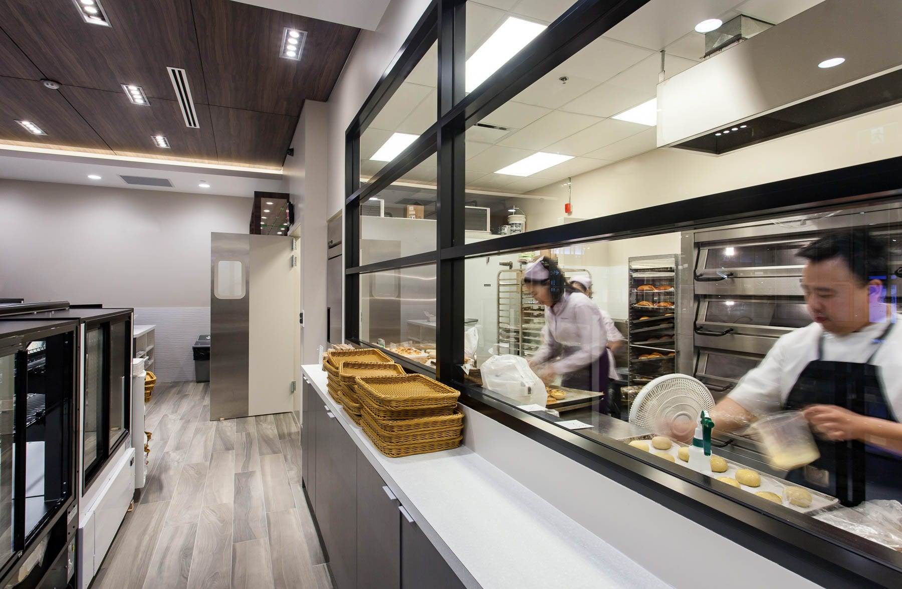 Staff baking in the kitchen at Saint Germain Bakery in Guildford Town Centre