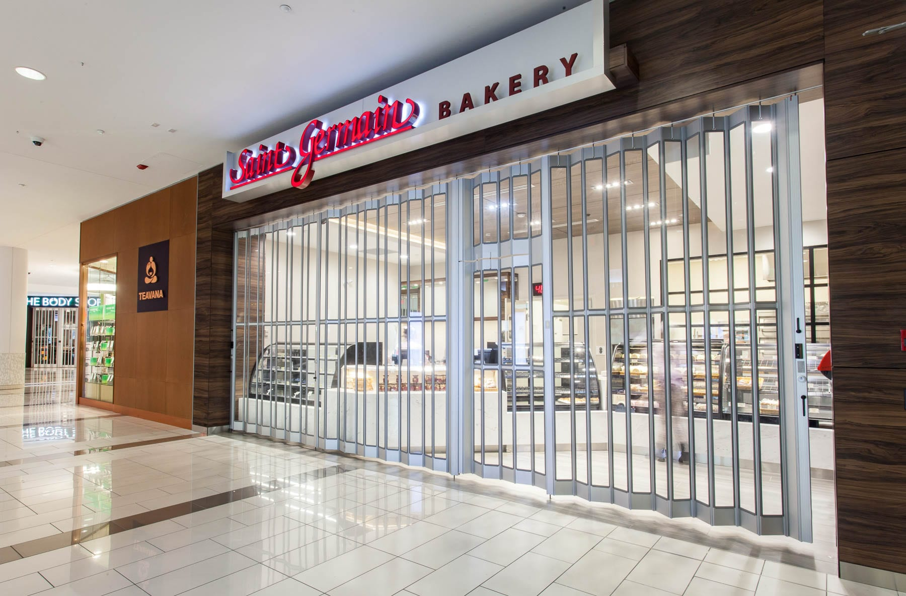 Electrical and rolling security grille for Saint Germain Bakery's renovation project